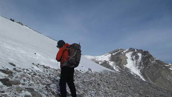Ben just about to tackle the last snow slope before the summit ridge