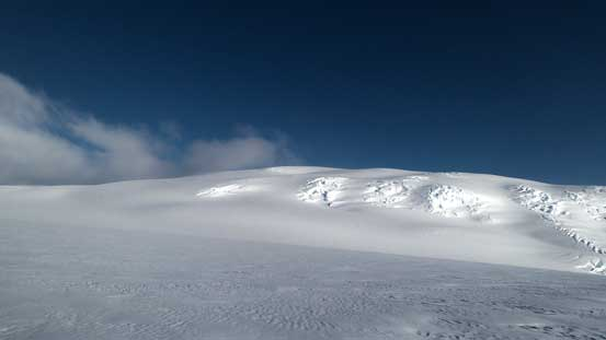 "Start to see the rounded summit ""hump"" of Snow Dome"