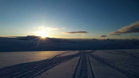 Gorgeous sunrise over Mt. Andromeda. Note the snowmobile tracks...