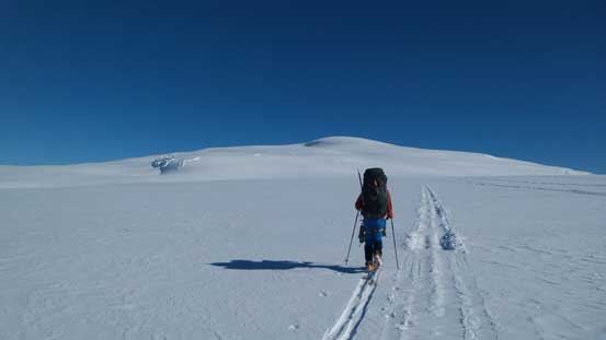 Ben skiing towards the rounded Snow Dome, just about to drop gears