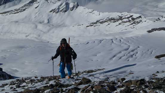 Ben ascending the S. Ridge of McDonell with the broken Simon Glacier behind