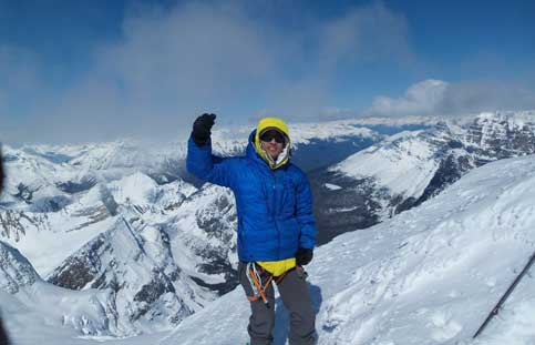 Me on the summit of Simon Peak, highest peak on the Ramparts