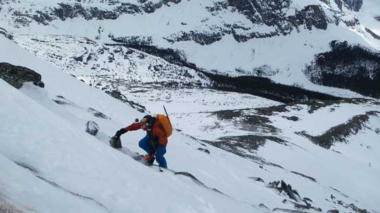 Ben boot-packing down the slope - a mix of boulders and snow