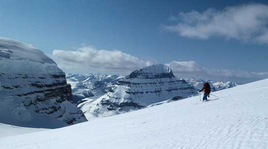 Ben skiing down Stutfield NE2, with Mt. Alberta in the background