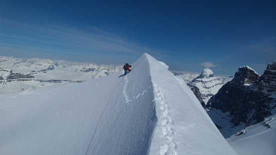 Here's a massive cornice to negotiate. Ben following my tracks, kicking in while facing inwards