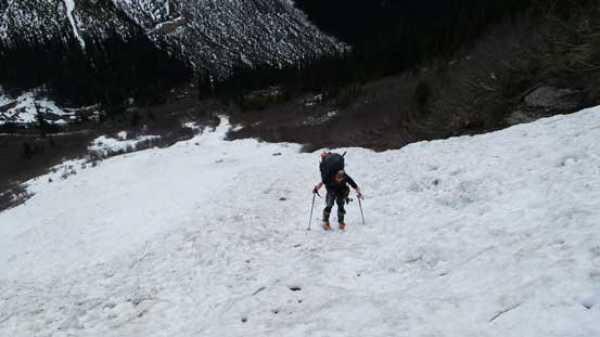 Now, ascending the obvious avalanche slide path. Ben was still trying to skin up