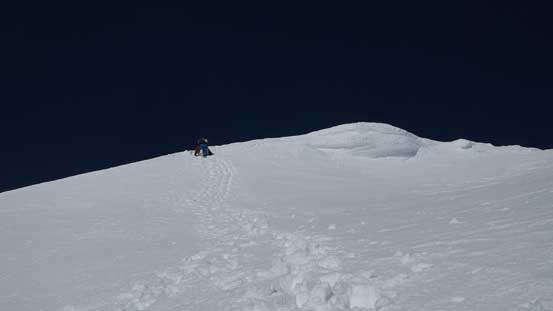 Starting the long down-climb. Firstly we had to drop down that summit cornice