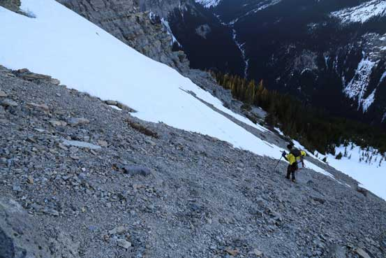Descending steep scree. Photo by Ben