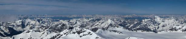 Panorama of a sea of peaks in BC Rockies. In the foreground are Alan Campbell, Arras and Rostrum and Icefall