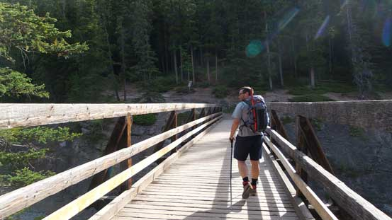 Eric crossing the critical bridge across Cascade River