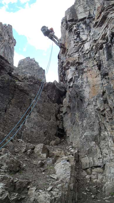 Ben rappelling the 5.6 crux into the deep notch.