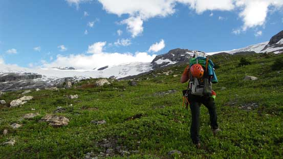 Traversing easy grassy terrain - would be a prime bivy spot too.