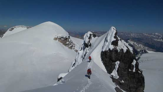 Cresting the summit ridge, looking back at Ben and Vern on a narrow section