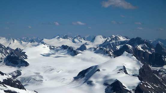Peaks on Freshfield Icefield rise behind peaks on Mons Icefield