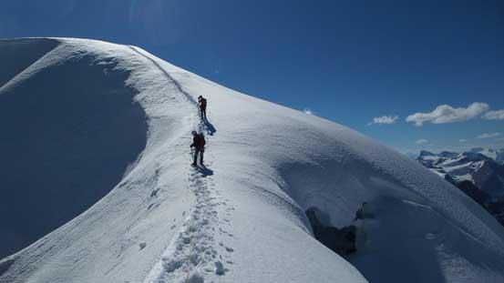 Descending the summit ridge