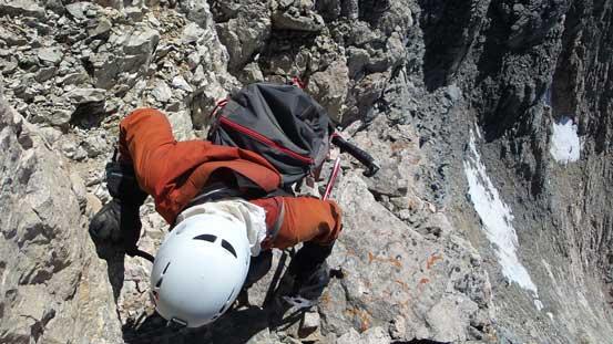 Ben down-climbing a rock step on the SE Ridge