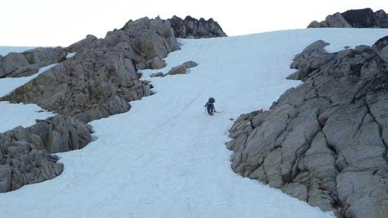 Eric down-climbing steep snow. It's also possible to use the rock rib on left