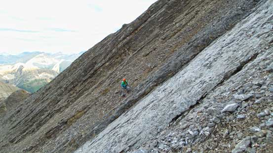 Vern picking a line up the steep scree to regain the ridge