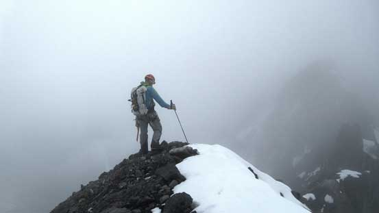 Vern on the false summit, checking out the route in a white-out