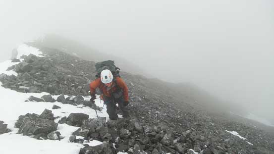 Ben ascending the last few meters to the false summit