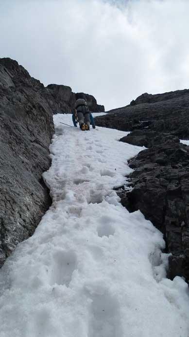 Vern down-climbing steep snow