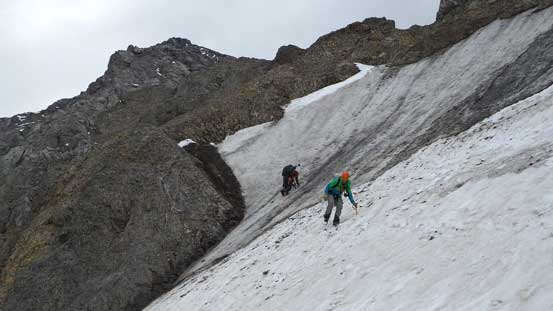 Ben down-climbing ice while Vern transitioning back on snow.