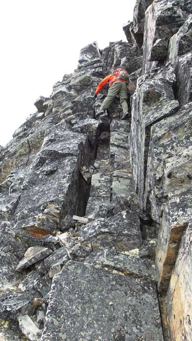 Down-climbing the summit block