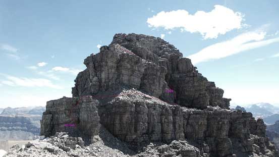 Here's a review of the summit tower. The lower band I attacked head-on was 4th class. The upper band that I ascended through a chimney on climber's right is the crux (4th with a few low 5th class moves).