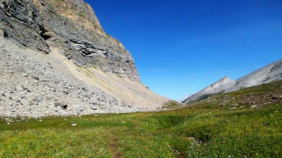 Hiking across a wide alpine meadow
