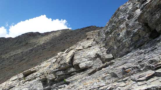 Traversing towards the higher peak. This is the typical terrain