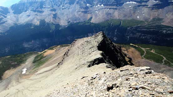 Continuing descending on this loose ridge.