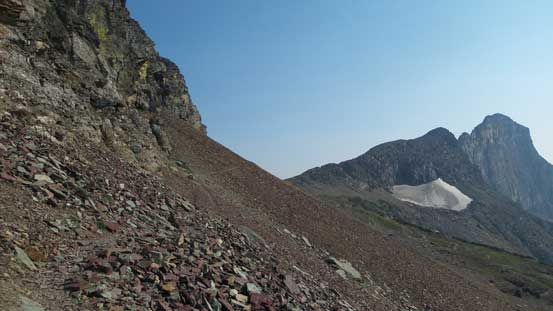 Traversing scree on a goat path around the W. side of Reynolds