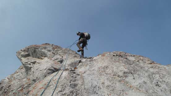 Robb rappelling the summit block (Rap 1)