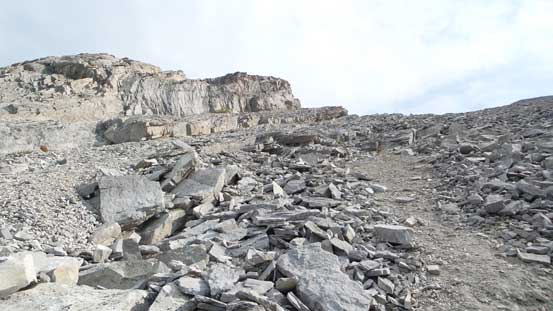 Slabs covered by loose rocks...