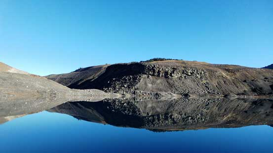 Cinder Cone and its reflections in the mud lake