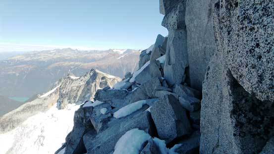 Traverse on a ledge, climber's left onto the N. Face