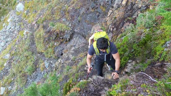 Mark negotiating a short scrambling step along the trail