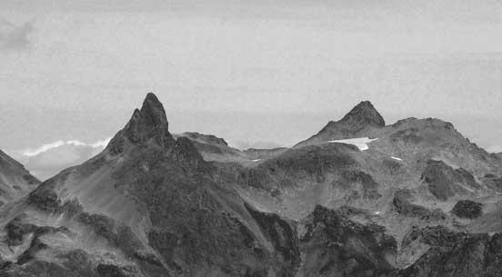 Baby Munday Peak is a technical summit on Cheam Range. Stewart Peak behind
