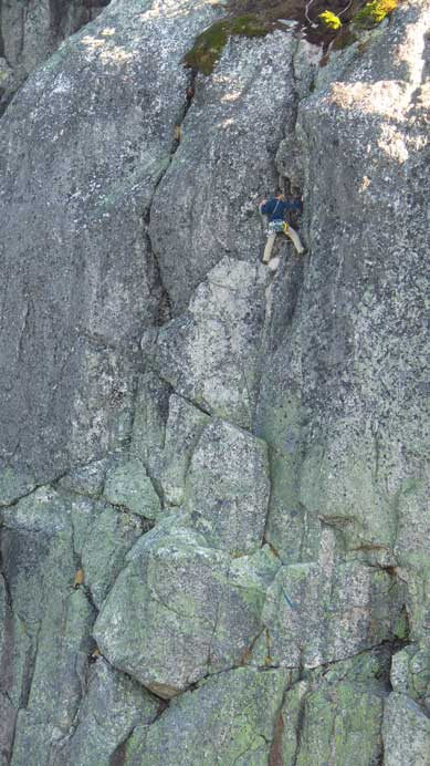 Looking back at the other climber leading the P2 on Escape Velocity