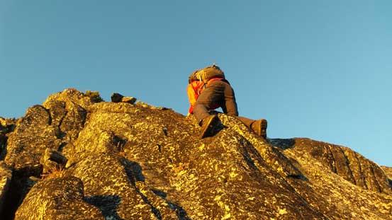 Ben down-climbing the tricky cliff band