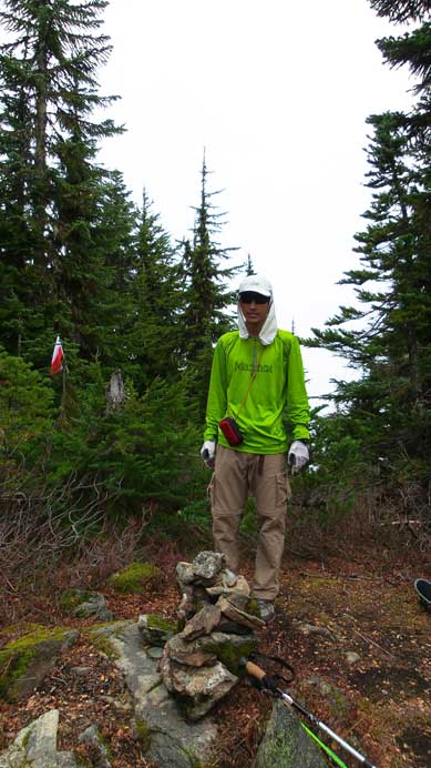 Me on the forested summit of Mt. Thurston