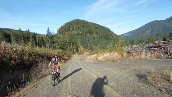 Simon biking up the road