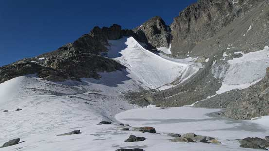 A frozen tarn by the upper basin. Note the ice arete behind