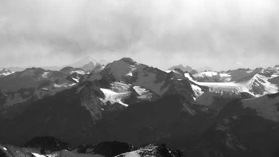 Nivalis Mountain by McBride Range. Behind way in the distance is Mt. Baker