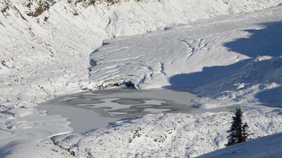 The toe of Helm Glacier and a frozen glacial lake