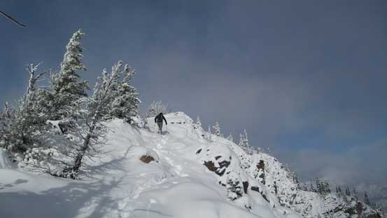 The terrain opens up towards the false summit