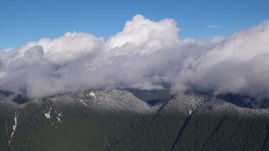 Clouds hovering above the forested bumps - Wizard Peak and Magic Peak