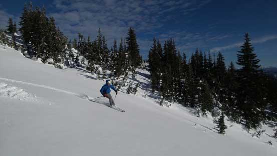 Alex having fun skiing down