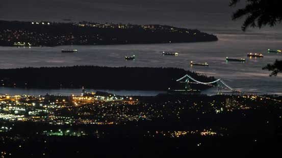 That bridge is the famous Lions Gate Bridge (usually has 1 hour traffic delay in the 'wrong' time)