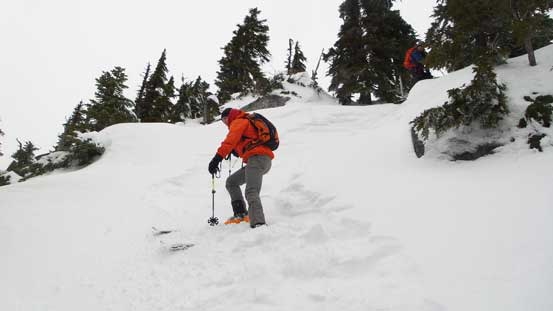 Skiing down the steep terrain from Iago towards the col